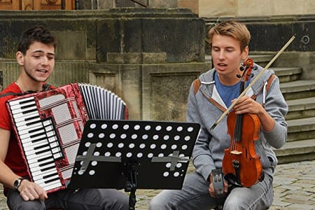 A boy band features a violinist and a squeezeboxer in Dresden's Altstadt (Old Town).