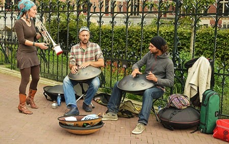 Hang musicians jam with a horn player in Amsterdam, outside the Rijksmuseum.