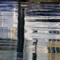 Abstract photo of fragmented objects and light reflecting back from water