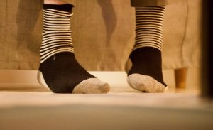 A closeup of two feet in striped socks