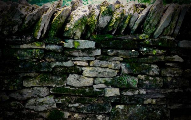 Close up of an aged stone wall